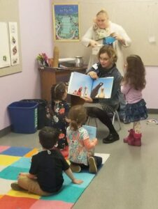 Pre-K class leaders read to children