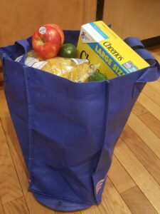 reusable grocery bag full of groceries