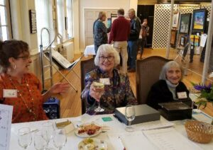 Greeters and hosts for the Art & Wine event