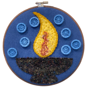 Beloved Community fabric art - a beaded flaming chalice and needlework