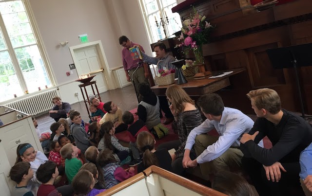 Children gather at the front of the sanctuary for story time