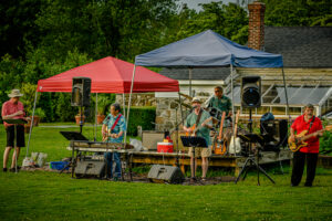 White Street Band members playing outdoors
