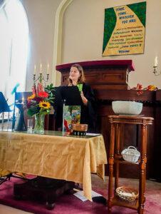 Rev. Lee at the altar