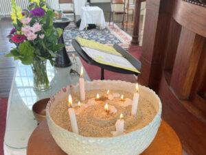 Joy-sorrow candles at the altar