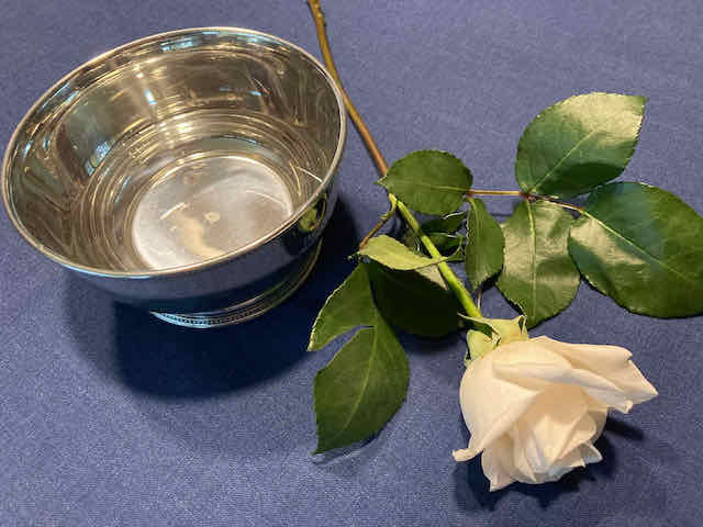 A rose by Lee's silver bowl used for child dedications