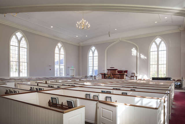 View looking across the pews from the back of the sanctuary, light from the windows casting reflections on the wall