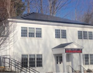 Solar panels atop the offices wing on Great Pond Road